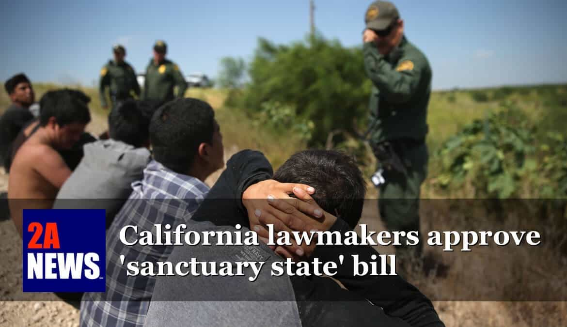 U.S. Border Patrol agents detain illegal immigrants after they crossed the border from Mexico into the U.S.