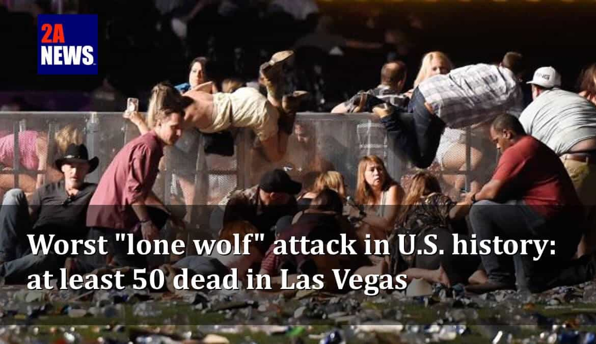 Concert goers scramble for cover as gunfire erupts at the Harvest Festival in Las Vegas, Sunday Oct 1, 2017